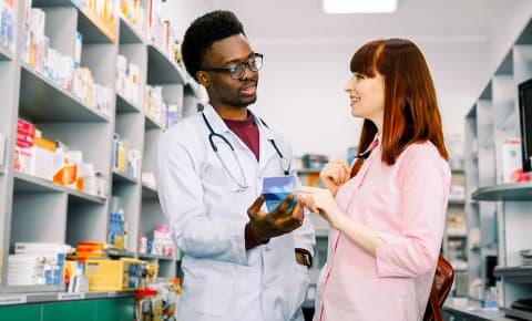 male pharmacist and female customer talking