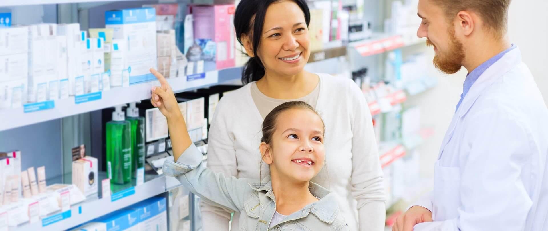 little girl smiling at the pharmacist