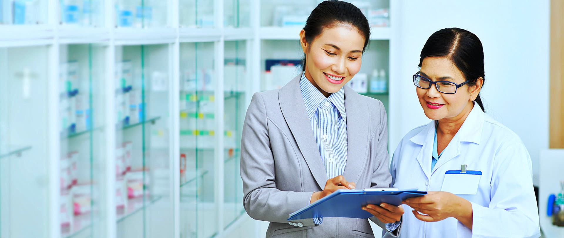 pharmacist with her manager reading
