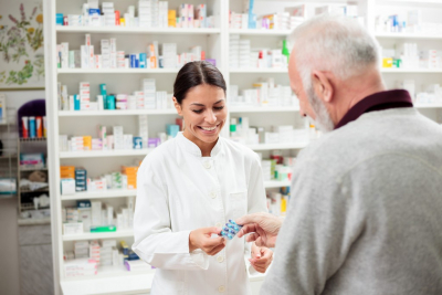 senior customer talking to a female pharmacist
