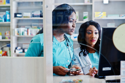 pharmacists looking at a computer