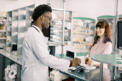 pharmacist and a lady customer talking