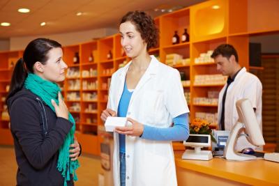 female customer talking at the pharmacist