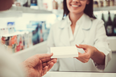 pharmacist smiling in the counter