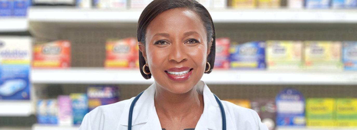 senior pharmacist smiling